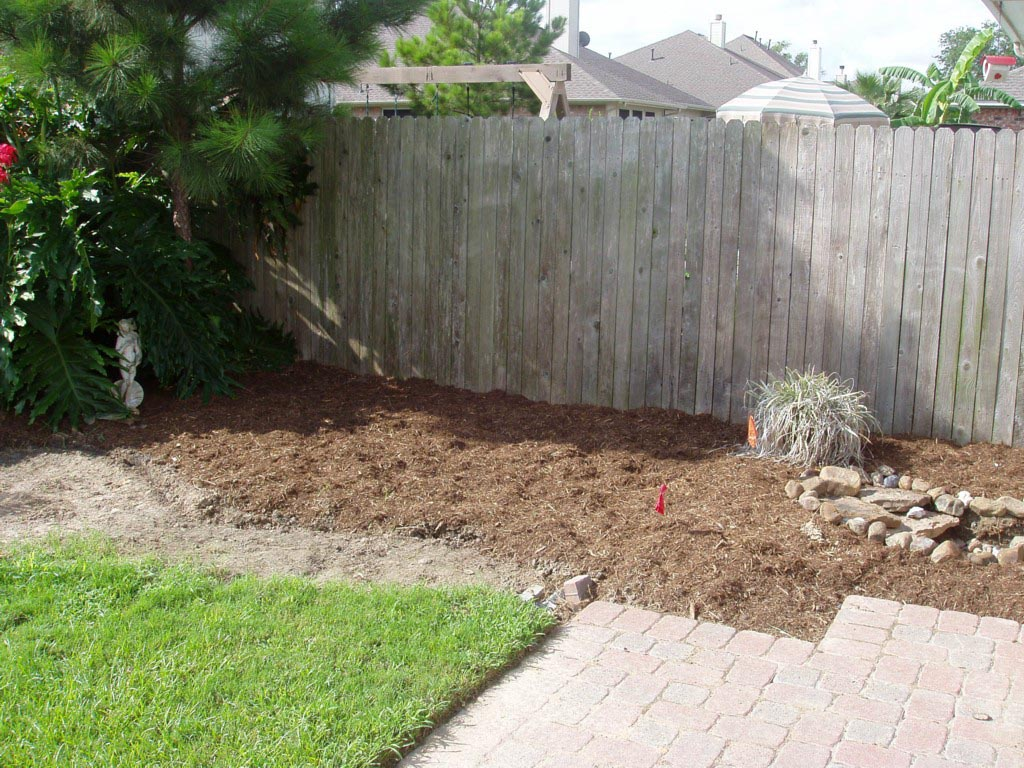 Raised garden bed against wood fence garden design ideas for Garden bed fence ideas